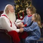 Santa talking to 2 sisters